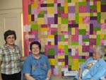 First Quilt: Gena Phillips with first quilt, Marilyn McShan and Wanda with her