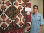First Quilt: Pam Parkinson with her first quilt