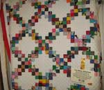 2nd place for large quilt Too Many Stitches by Elsie Graham of Bryson, Busy Bee member